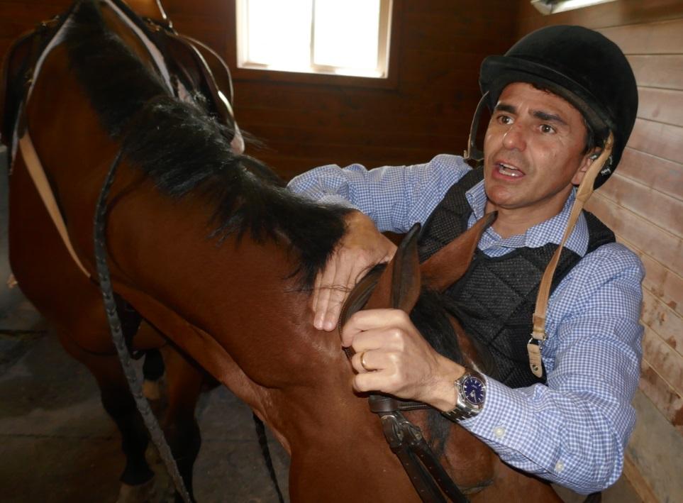 Eurico Rosa da Silva puts bridle on Athena