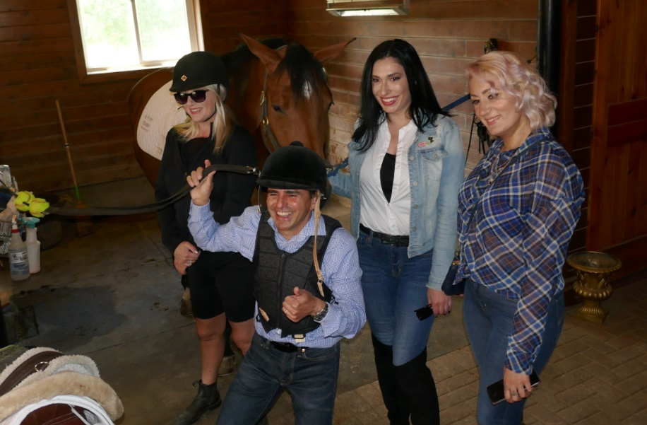 group photo with all the gals at the horse barn